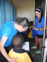 Karen Hinckley helps with children's physicals.