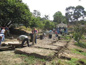 Volunteers clear out dilapidated garden beds