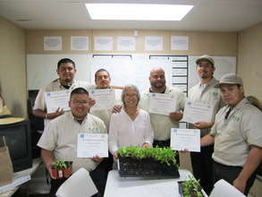 Corpsmembers get training from a Master Gardener