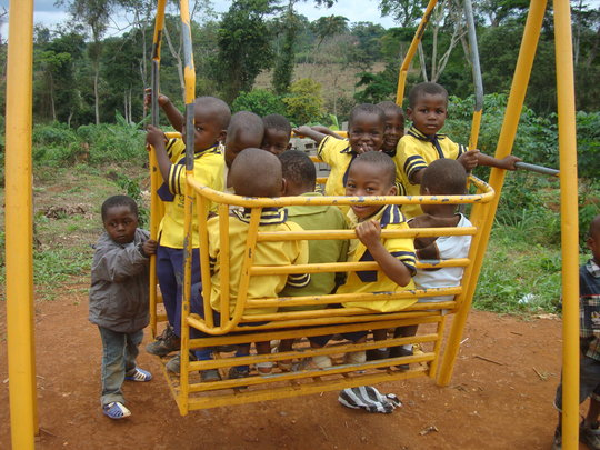Children playing at the school swing