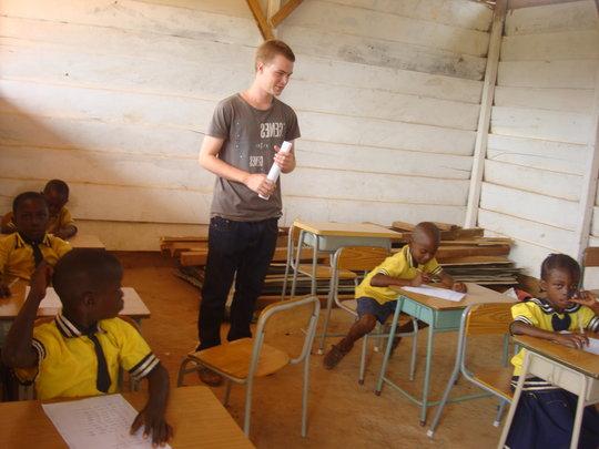 A volunteer supervising exams