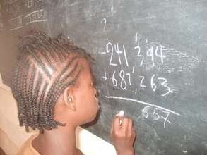 A Child Writting on the Board