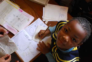 Nursery two pupil in class studying