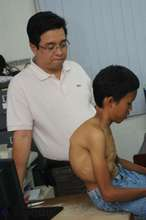 Dr. Cauilan examines child with an 80 degree curve