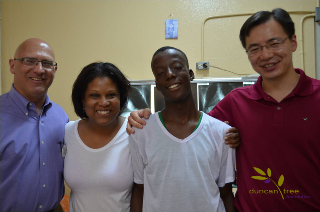 A former Duncan Tree Patient with volunteers