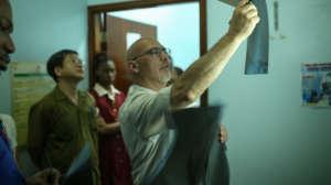 Dr. Paonessa examining patient xray