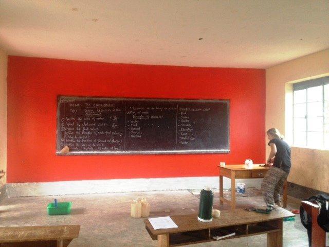 Painting Primary 6 Orange in the Rainbow School