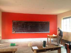 Painting Primary 6 Orange in the Rainbow School