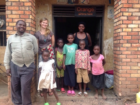 Olive and family with MCF Peace Corps Volunteer