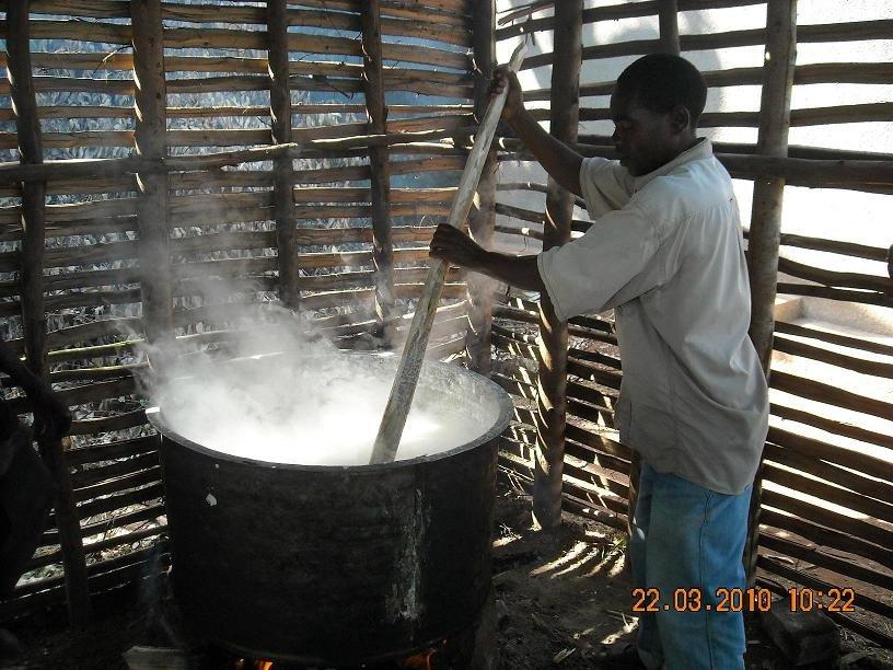 The Cook at Rushakyi Prepares Porridge