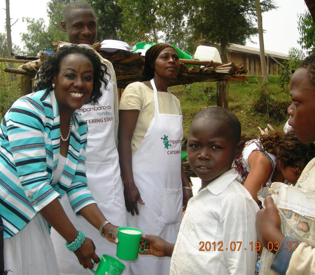 MCF President serves porridge at Nyamiyaga Primary