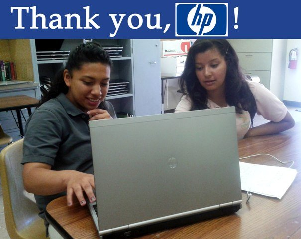Students using one of our new HP laptops