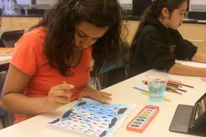 Xiomara,12, participating in illustration workshop