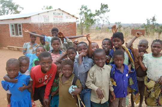 Kids in the program in front of the orphanage