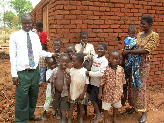 Noel and Enifa and some of the kids they care for