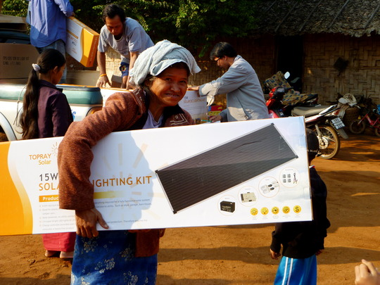 One of the residents and her new solar panel
