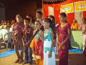 Children doing a group song on their Annual Day