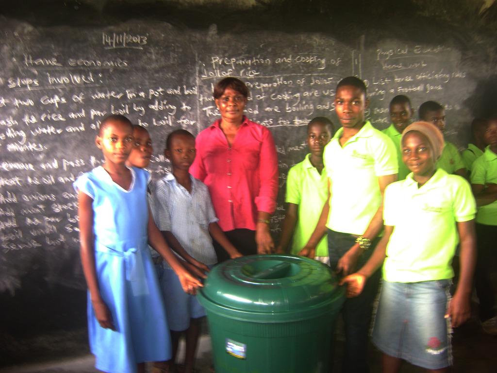 MIND kids from Aluu donated wastebins to schools