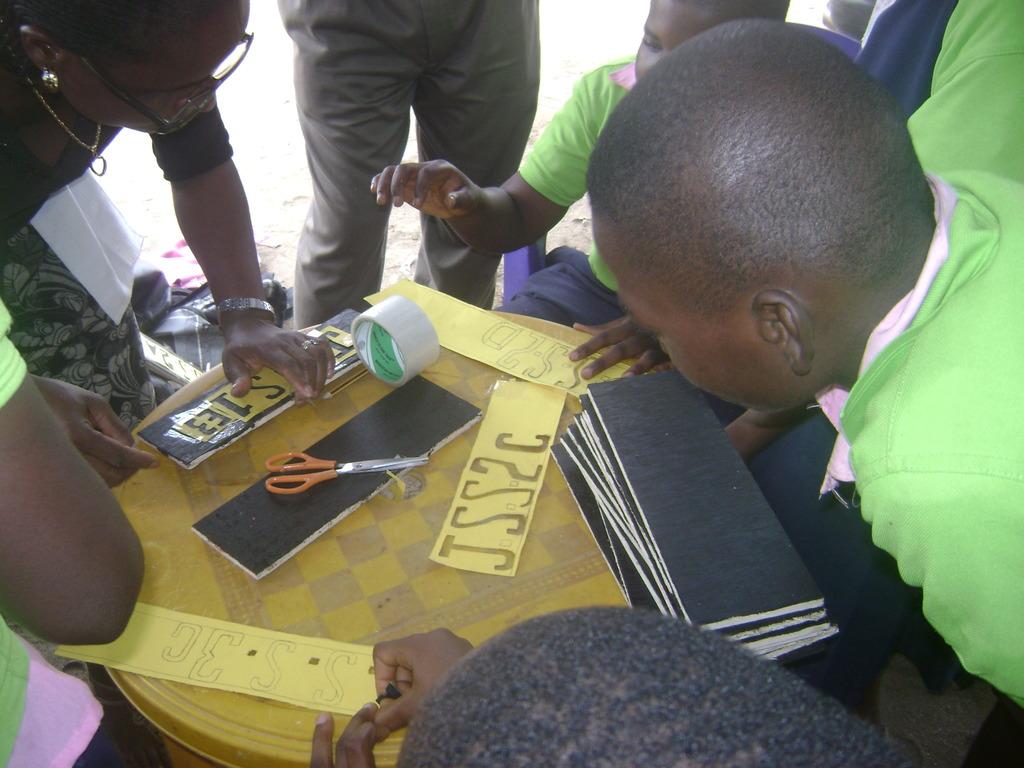 MINDkids in Rumukwurushi working on their signpost