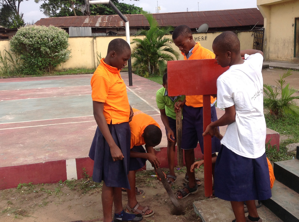MIND kids from Amadi-Ama working on their signpost