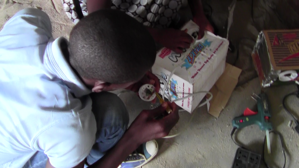Students using scraps to build a Food Warmer