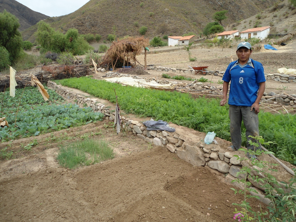 Young man working in his family garden in Tarabuco