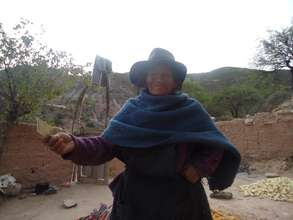 Older woman showing earnings from produce sale