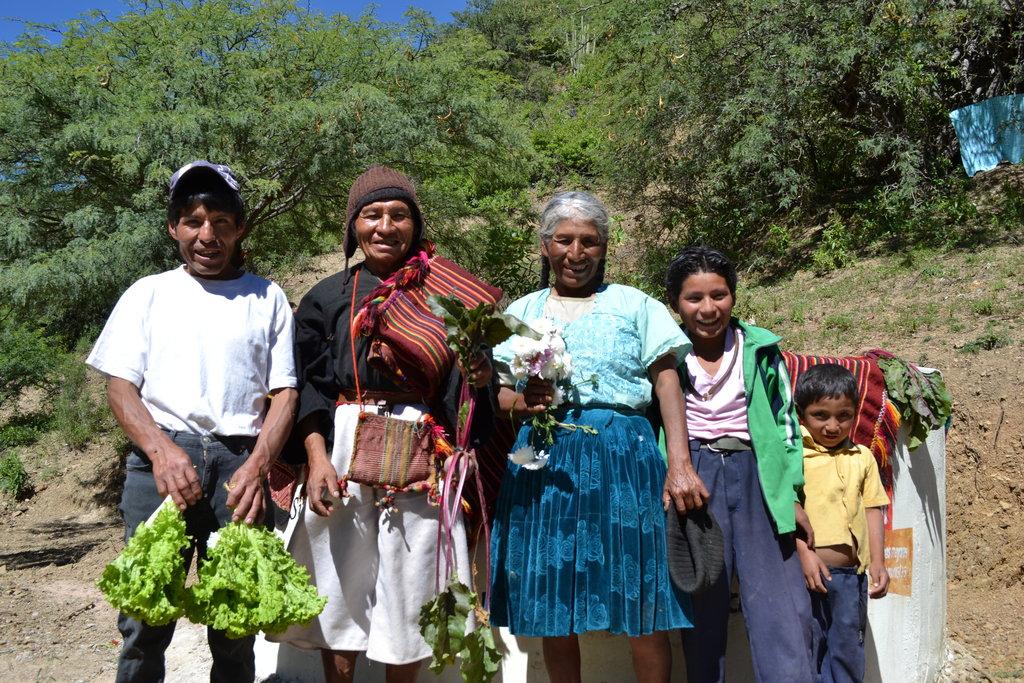 Dario Velasquez (65) & his family with water tank