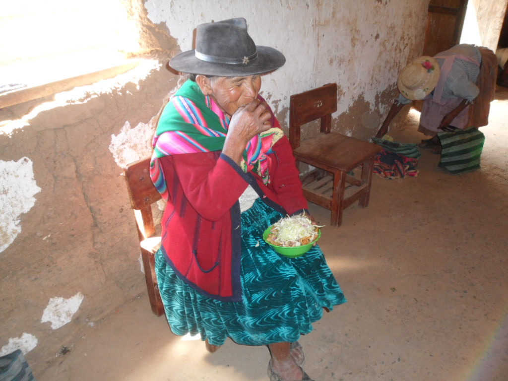 A woman eats lunch with vegetables from the garden