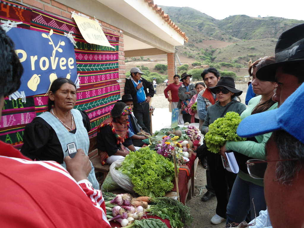 Older people & their families selling produce