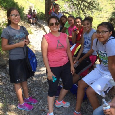 Young women  resting on way to top of Bear Butte