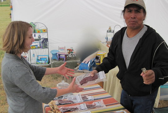 Selling bison meat at local fair