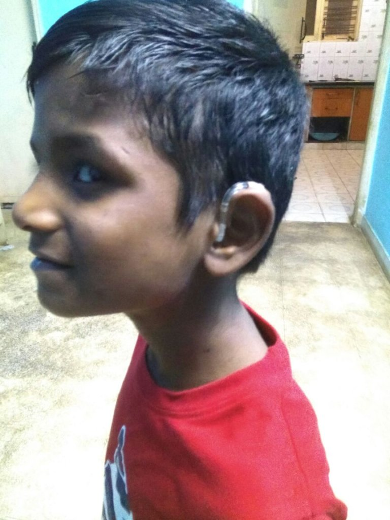 Anand with his hearing aid