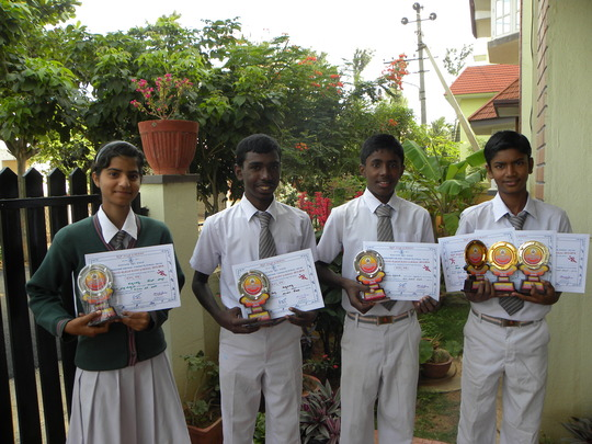 Children with certificates and trophies