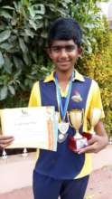 Dayanand posing with his achievements