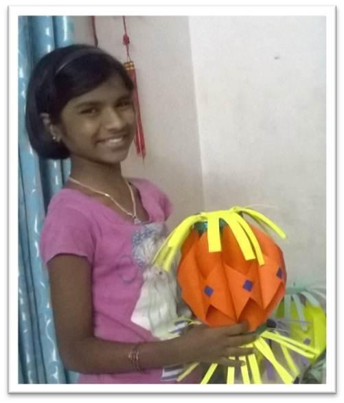Saraswathi with the lantern she made