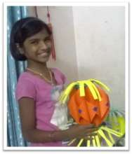 Saraswathi with the lantern she made