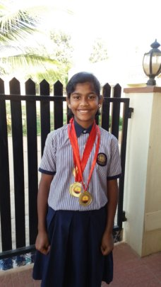 Pooja with her gold medals