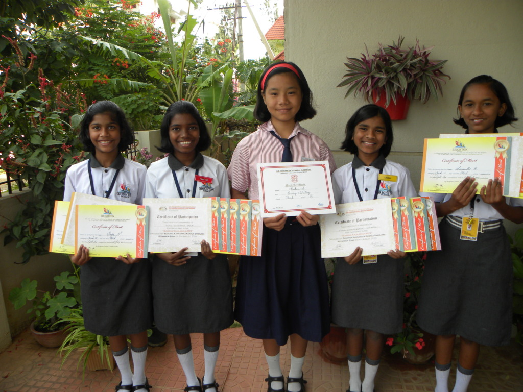 Girls Posing with their medals from Sports Day