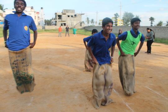 Boys playing sack race