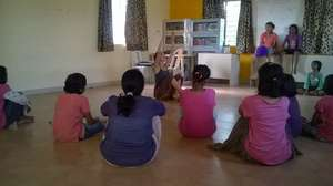 Girls learning dance from an Volunteer