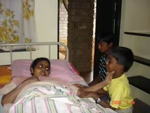 Shoba with her sons a few days before she expired