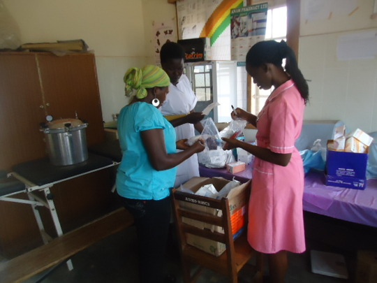 A health facility unpacks new supplies