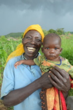 Beneficiary and her grandson on their peanut farm.