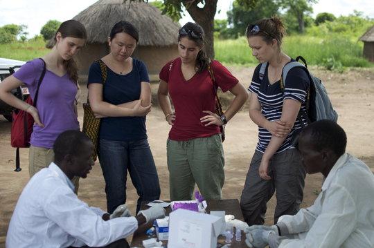 Denis teaches GROW interns about rapid HIV testing