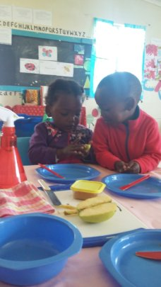 Little ones preparing their snack for the day