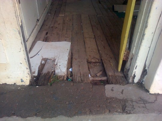 A desperate looking floor awaiting urgent repair