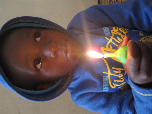 Lighting a candle for Tata Madiba