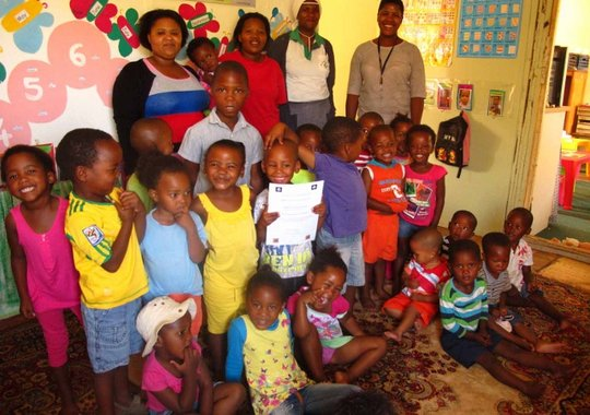 Proud staff and children