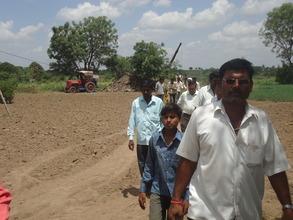 Mayor leading the village tour